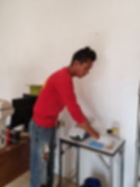 Daniel with testing machine.jpg