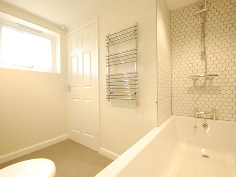 AFTER INSTALL OF NEW BATH/SHOWER UNIT