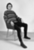 Editorial portrait, black and white person on a chair by photographer Pagy Wicks