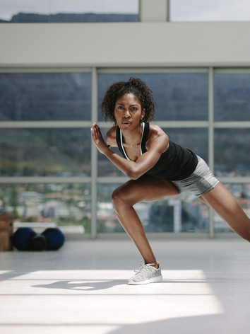 Canva - African Woman Exercising in Gym.