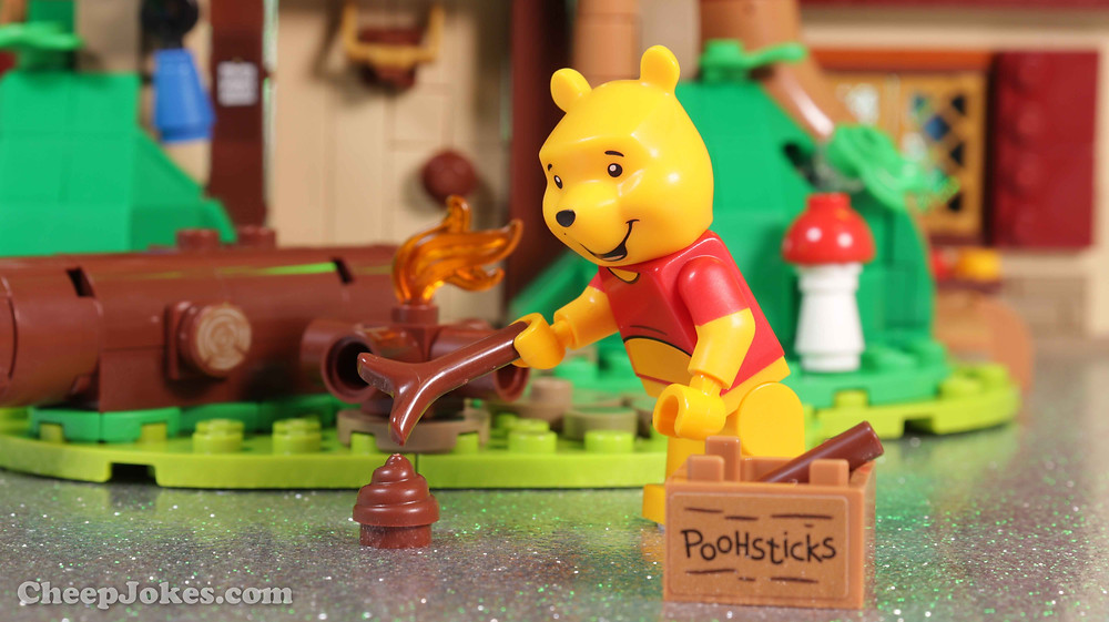 Take time out and rekindle joyful childhood memories with this LEGO® Ideas set (21326) featuring Disney's Winnie the Pooh and a delightful LEGO brick recreation of Pooh Bear's house under a big oak tree in Hundred Acre Wood. Great to build alone or with family, the house opens at the back for easy access to the authentic details inside, including Pooh's buildable armchair, Pooh-Coo clock, Poohsticks, honey pot elements and much more. You can also create the effect of bees flying around beehives in the branches of the tree, like in the stories. Popular characters The model comes with Disney's Winnie the Pooh, Piglet, Tigger and Rabbit minifigures, plus an Eeyore LEGO figure. The friends each have an accessory, including Winnie the Pooh's buildable red balloon, to recreate classic scenes. Special gift Part of a collection of premium-quality LEGO building kits for adults, this set makes a charming gift for yourself, a Disney Winnie the Pooh enthusiast, LEGO fan or any hobbyist.
