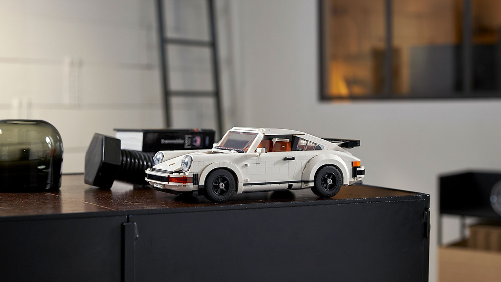The LEGO® Group has wound the clock back to the era of big hair, new wave and punk rock for the launch of the latest LEGO car set, the two-in-one LEGO Porsche 911 Turbo and 911 Targa bridges the gap across two decades to unite this pair of iconic sports cars.  To celebrate the latest LEGO version of the ubiquitous rear-engined German sports car, LEGO has collaborated with Porsche to recreate a selection of the most vivid adverts from the model's history, this time starring the smaller but equally desirable LEGO namesake.