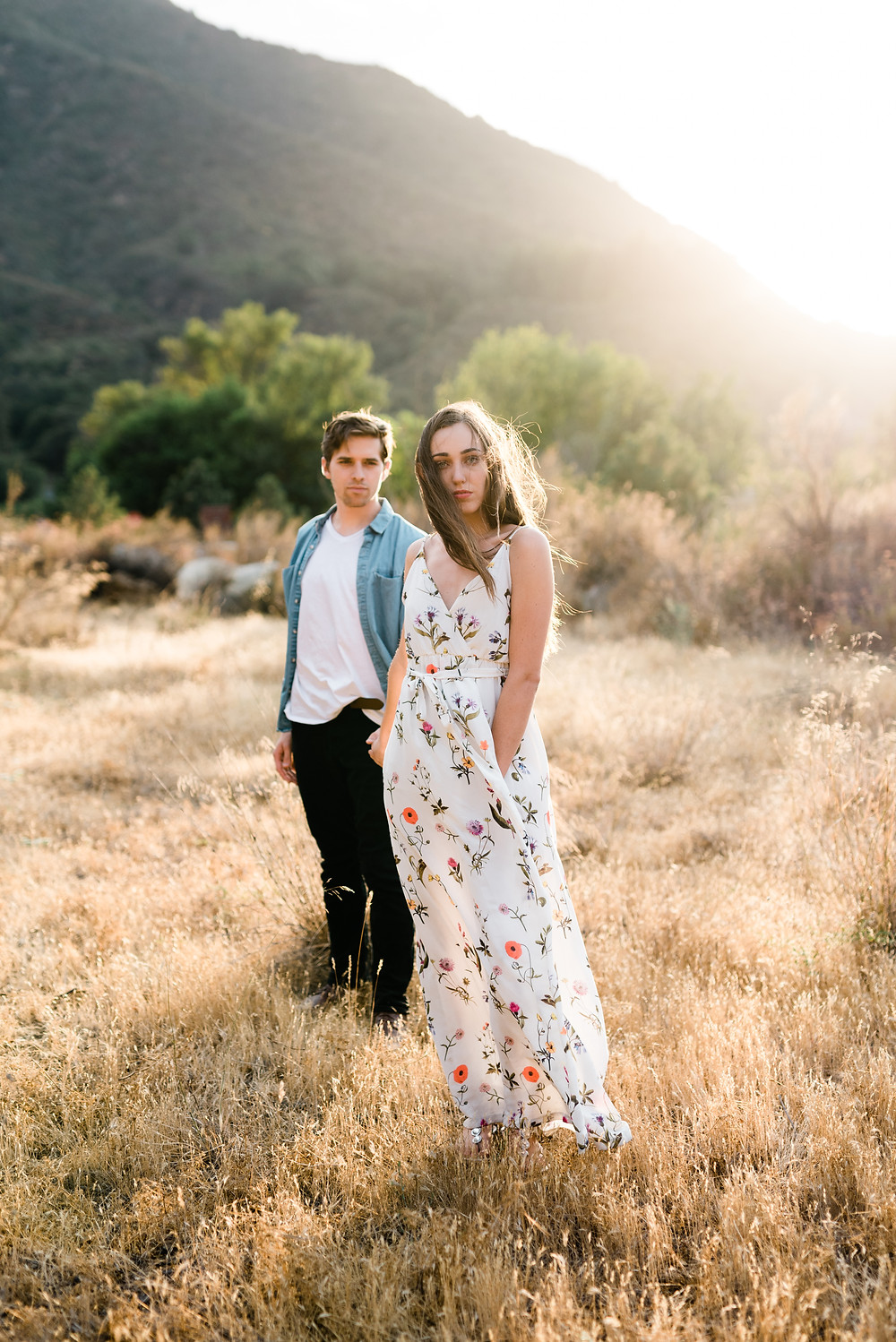 girl leading engagement pictures in California forest