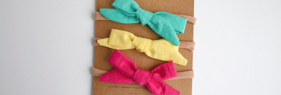 set of three hair bows in turquoise, yellow, hot pink