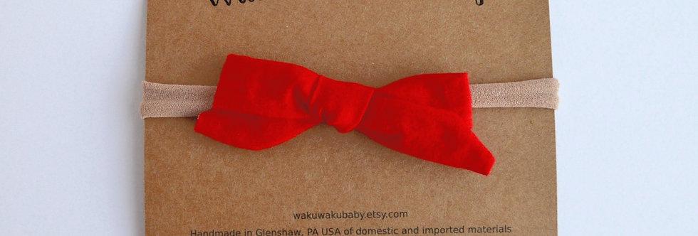 Red school girl style hair bow on headband