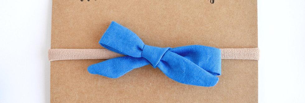 Blue school girl style hair bow on headband