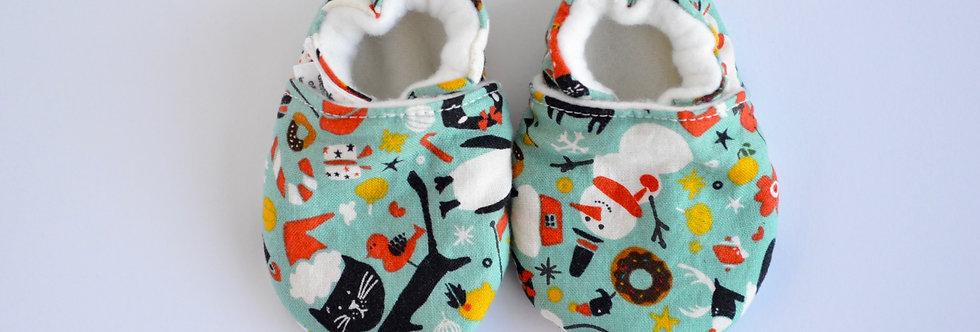Baby shoes in christmas print