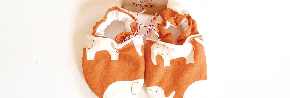 Baby shoes in orange elephant