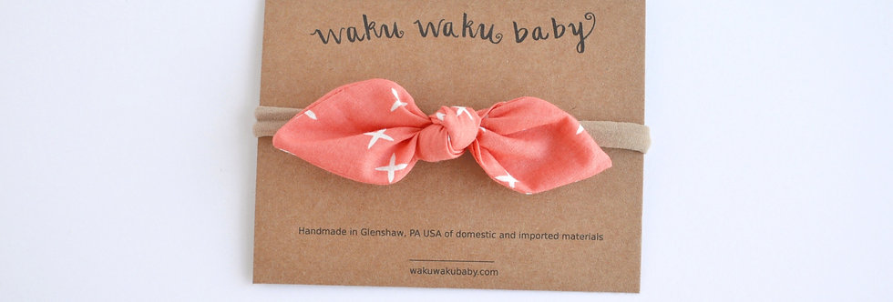 Organic cotton hair bow in coral