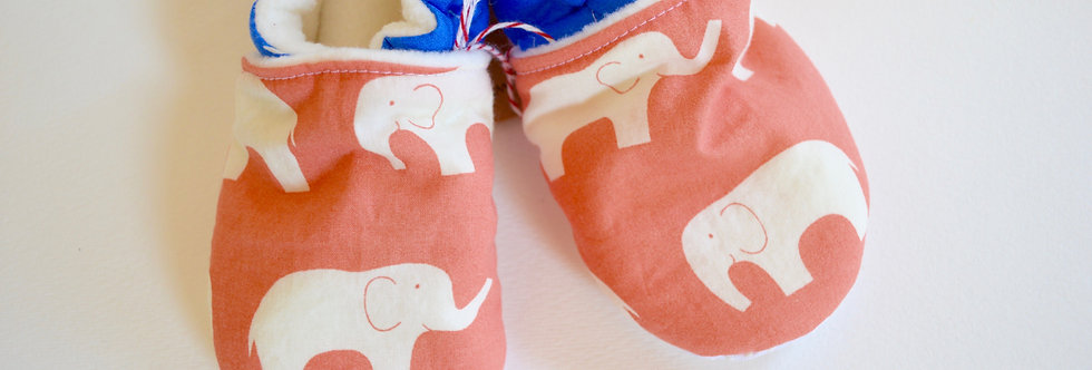 Toddler slippers in coral elephant and blue ribbon design close up