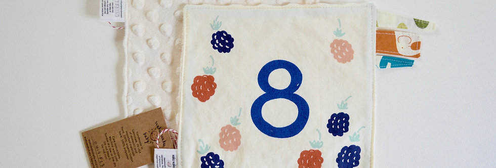 8 berries on sensory lovey with ivory backing