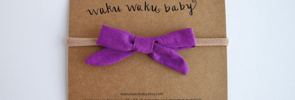 purple schoolgirl hair bow on headband