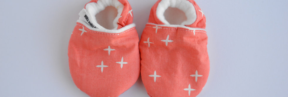 baby shoes in coral