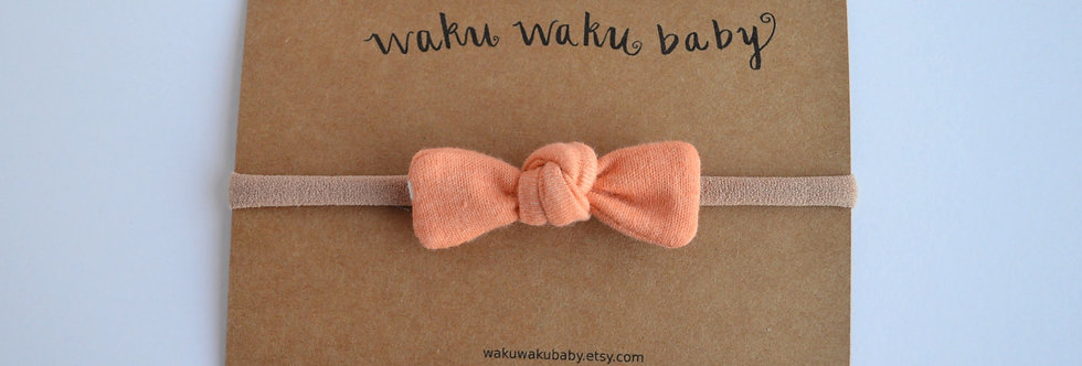 small coral hair bow on headband