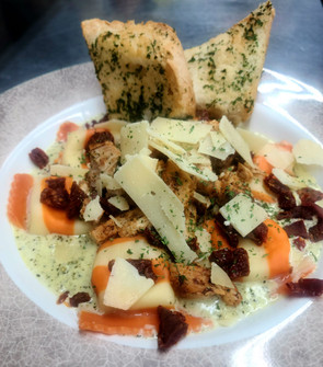 Goat cheese stuffed ravioli with basil c