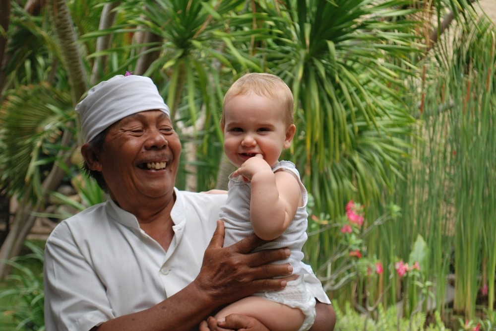 Happy staff and baby at the Villa Sanur