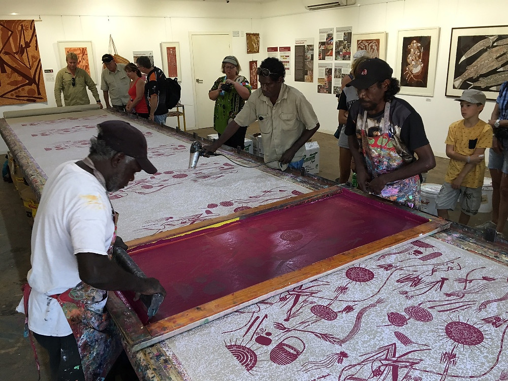 Screen printing fabrics at Injalak Arts Centre in Gunbalayna
