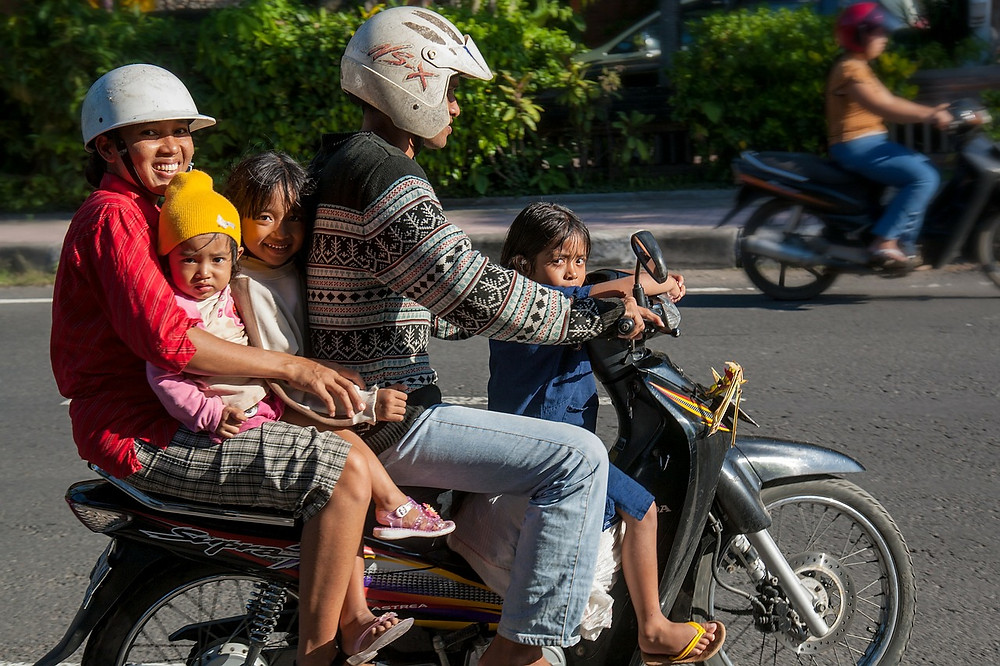 Balinese family with baby on scooter