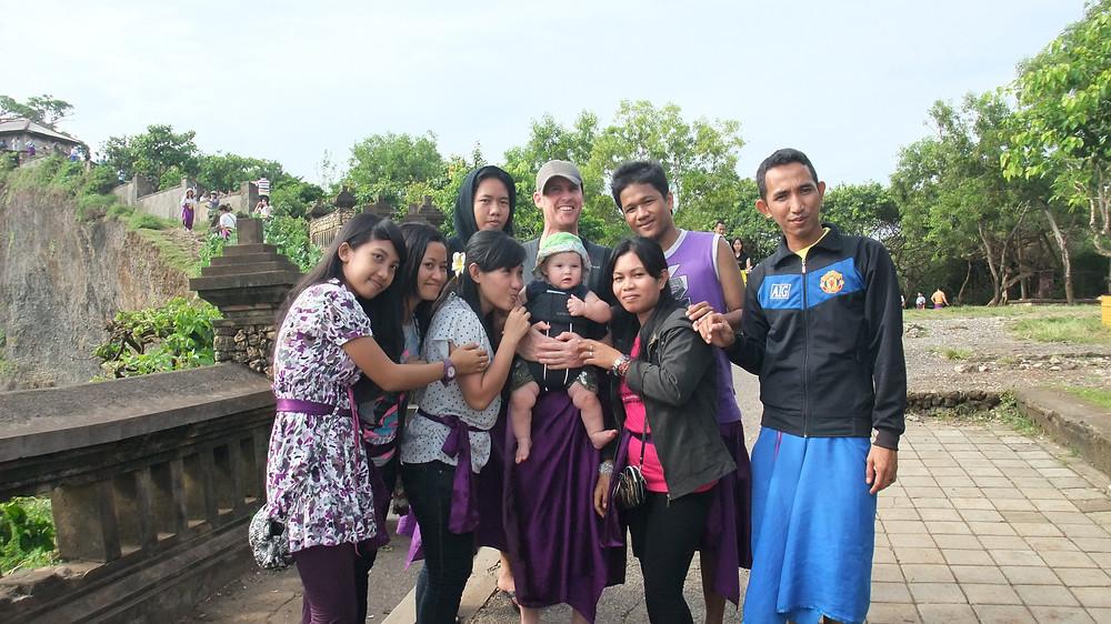 Family with baby at Uluwatu Temple, Bali