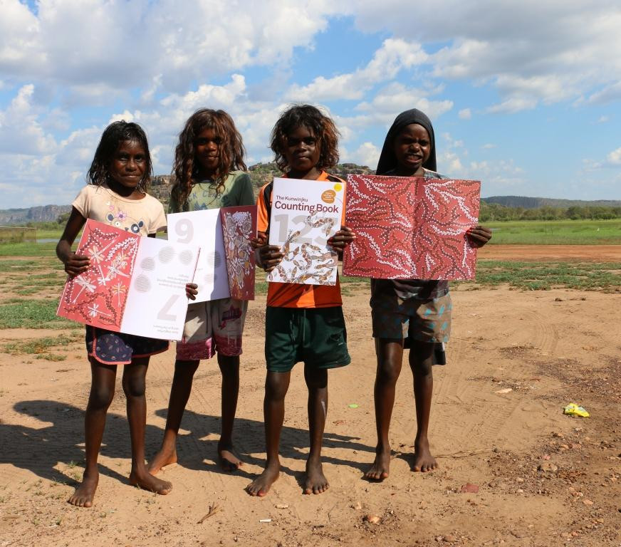 Aboriginal children at Gunbalayna in Arnhem Land with the Kunwinjku Counting book