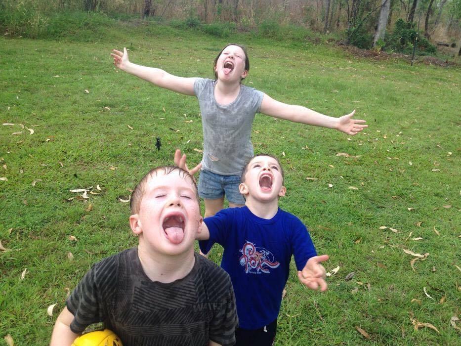 Darwin kids in the rain