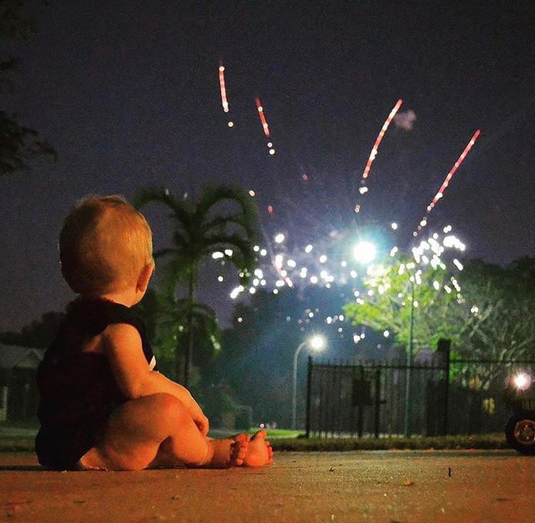 Child watching fireworks in Darwin