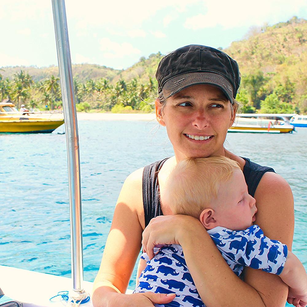 Mother and baby in boat at Nusa Lembongan Island, Bali