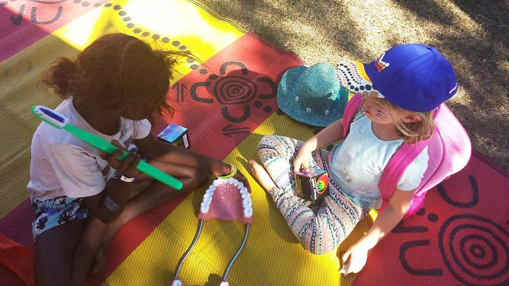 Kids from Barunga Aboriginal Festival playing with kids from Darwin at the Barunga Aboriginal festival, Northern Territory