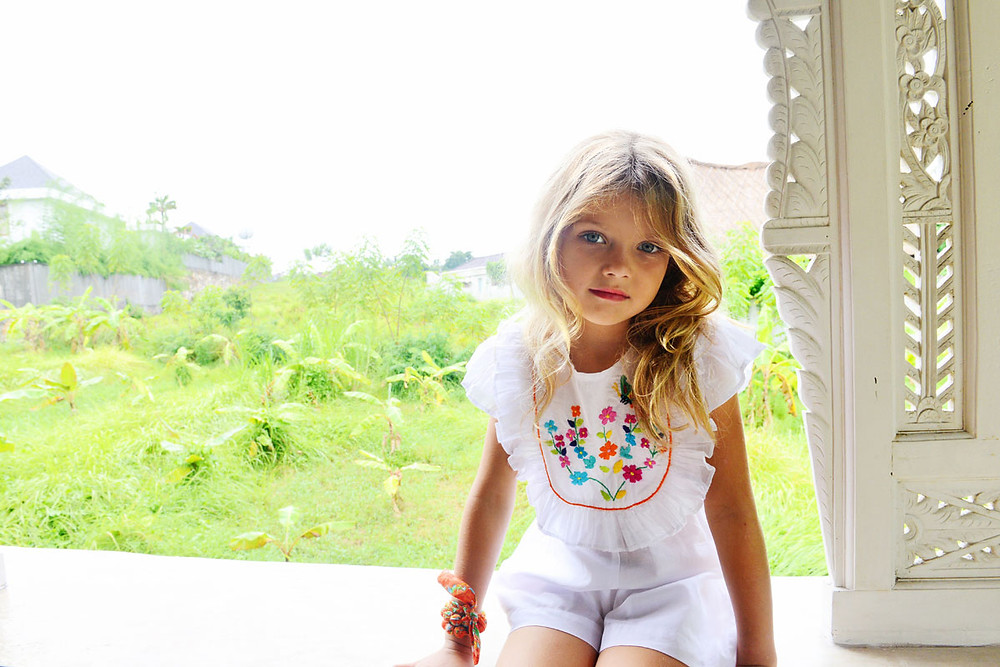 Little girl wearing childrens' fashion clothes in Bali