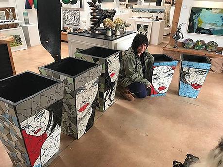 Artist with art work at Matakana gallery