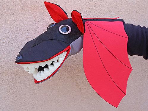 Títere de murciélago negro con alas rojas