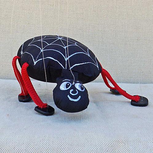 Marioneta de hilos araña negra