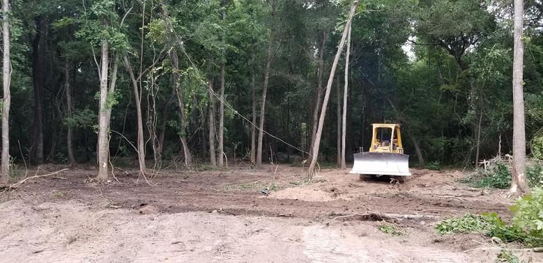 bulldozer underbrushing 3 acres