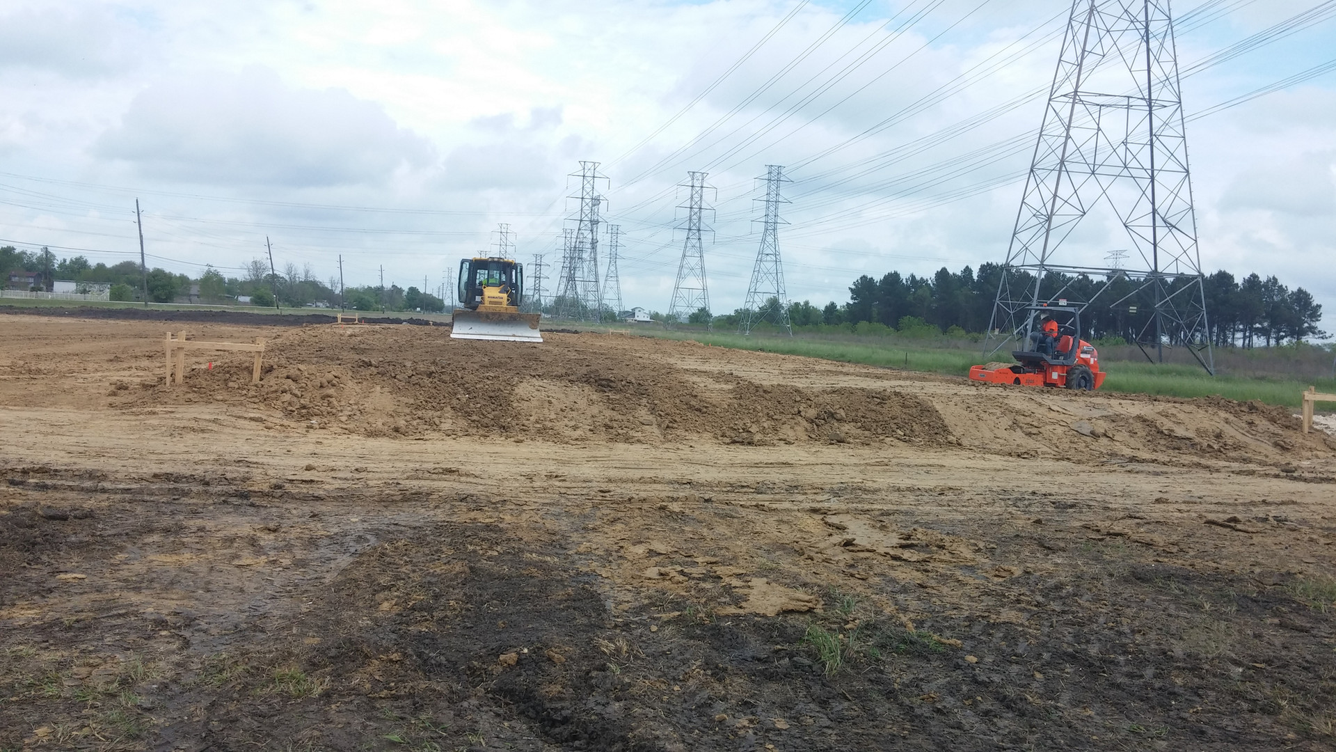 pad site with dozer and roller in distance