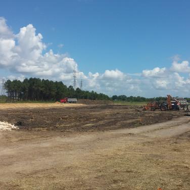 dump trucks prepping for pad site