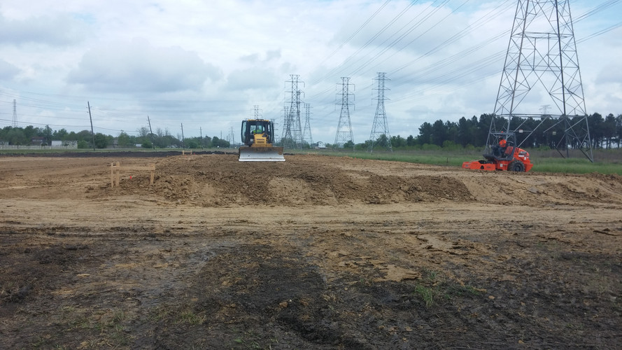pad site with dozer and roller