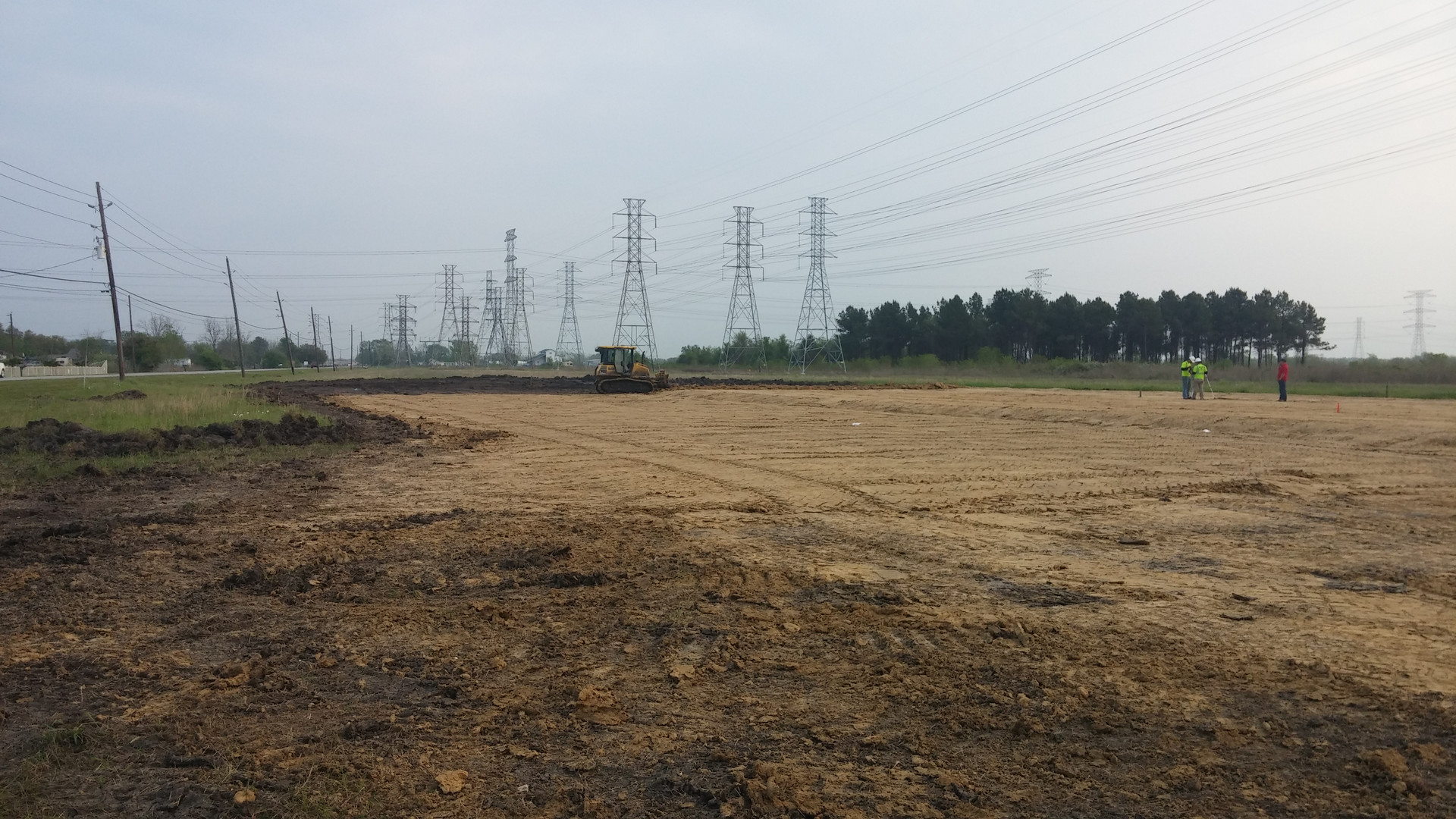 pad site with dozer in distance