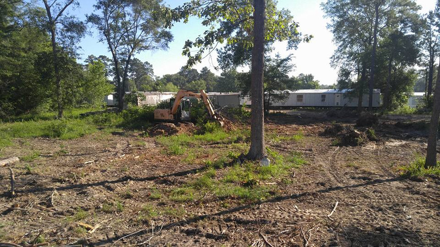 5 acre track being cleared by excavator