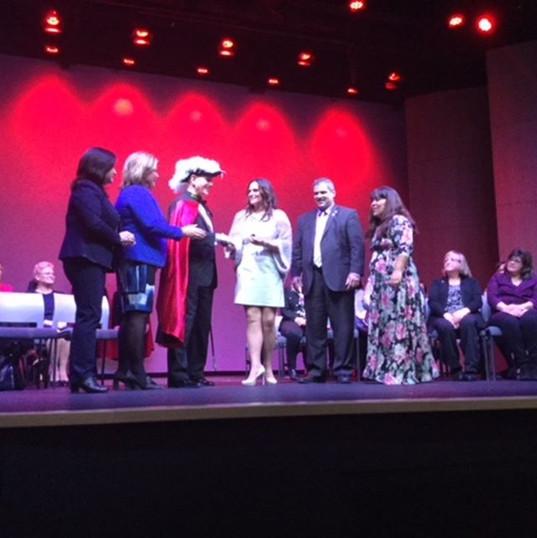 Ana-Maria receiving a volunteer of the year award