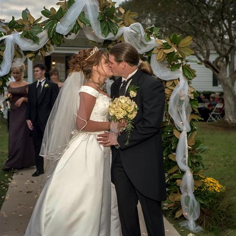First kiss bride and groom at Azalee Plantation