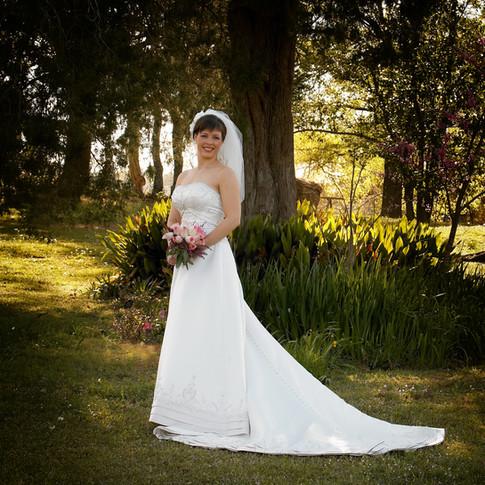 Bride in lush landscaping at Azalee Plantation