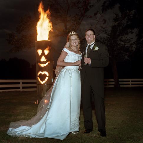 Bride and groom with bonfire at Azalee Plantation