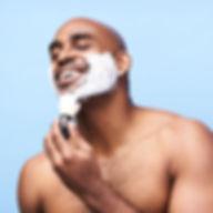 Male model applying shaving cream
