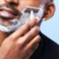Man shaving face