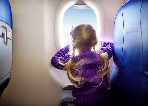 Adorable little girl traveling by an air