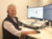 Sharyn at Desk small.jpg