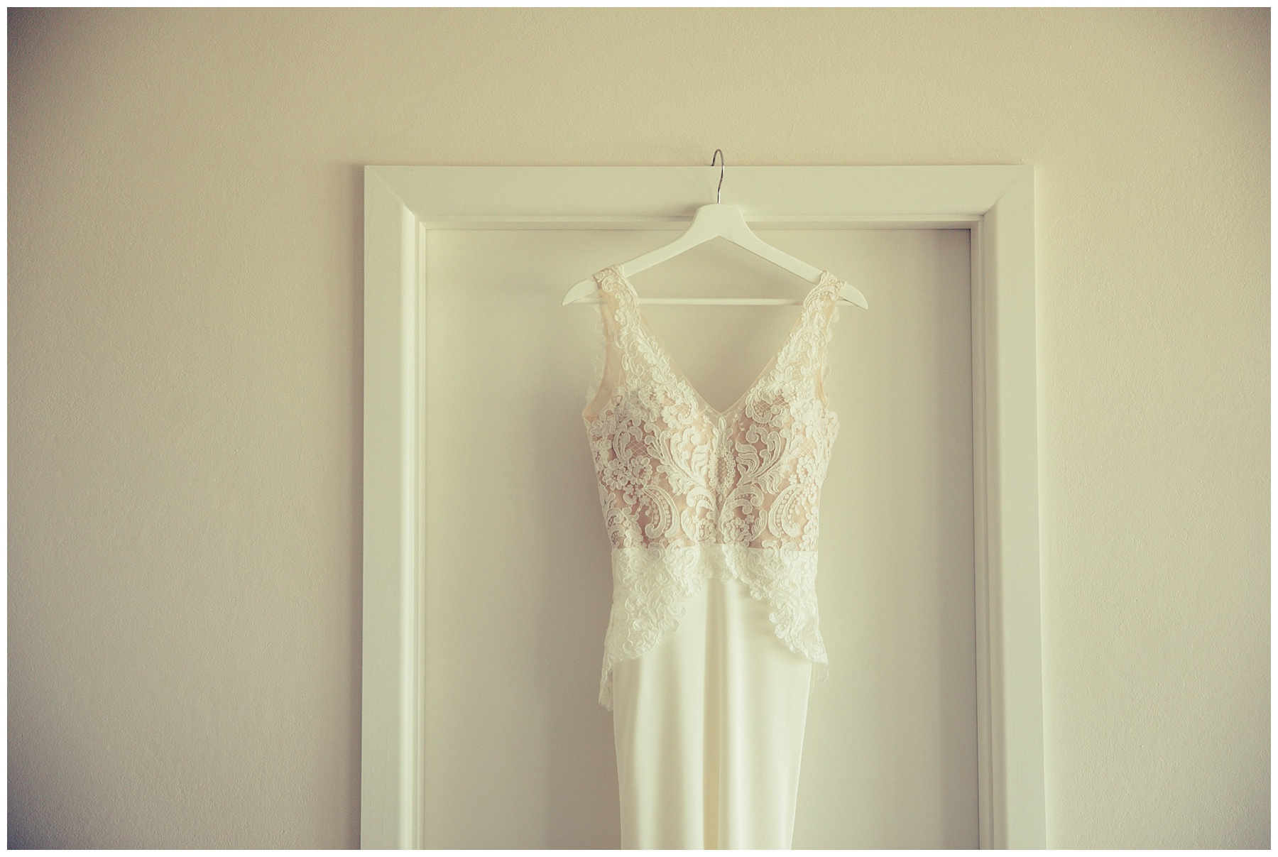 Helen English wedding dress hanging on door