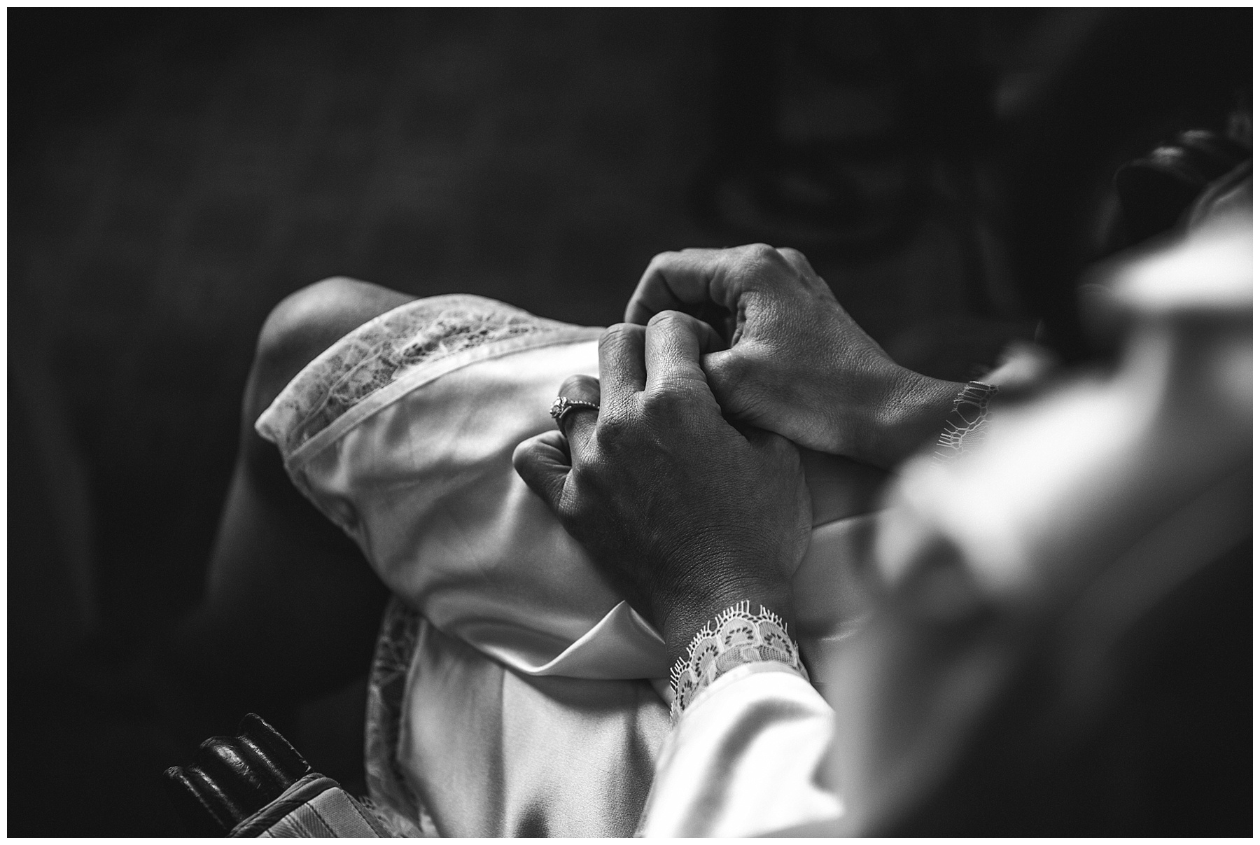Bride nervously holding hands in lap during bridal prep photographed by Blue Mountains wedding photographers de lumière photography