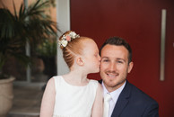 Father and daughter share a kiss on his wedding day - de lumière photography