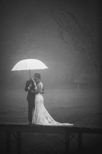 Bride and groom snuggle under their umbrella during the bridal portraits - Sydney Wedding Photographer de lumière photography